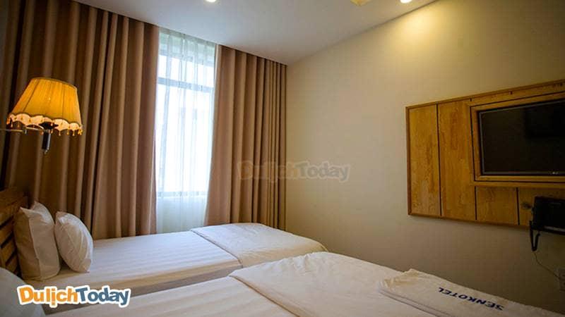 Phòng ngủ tại Senkotel với phong cách đơn giản ấm cúng