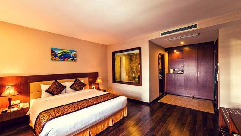 Không gian ấm cúng trong mỗi phòng nghỉ tại Khách sạn Hidden Charm Hotel