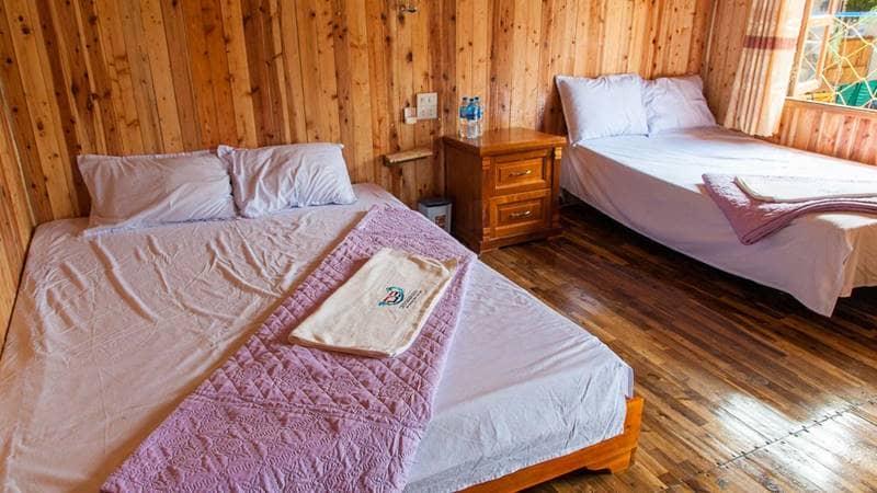 Phòng nghỉ 2 giường đôi dành cho 4 người ở resort. Nguồn: Cotodragonbeach