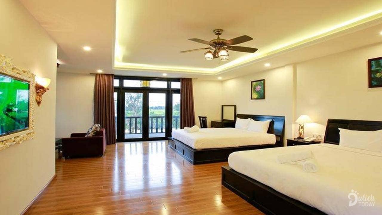 Phòng ngủ với nội thất sang trọng với tone màu ấm cúng